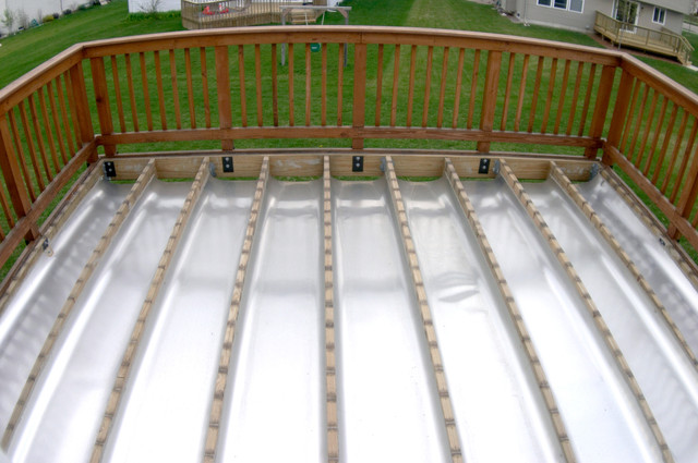 Adding a garage under a deck community for Garage roof deck plans